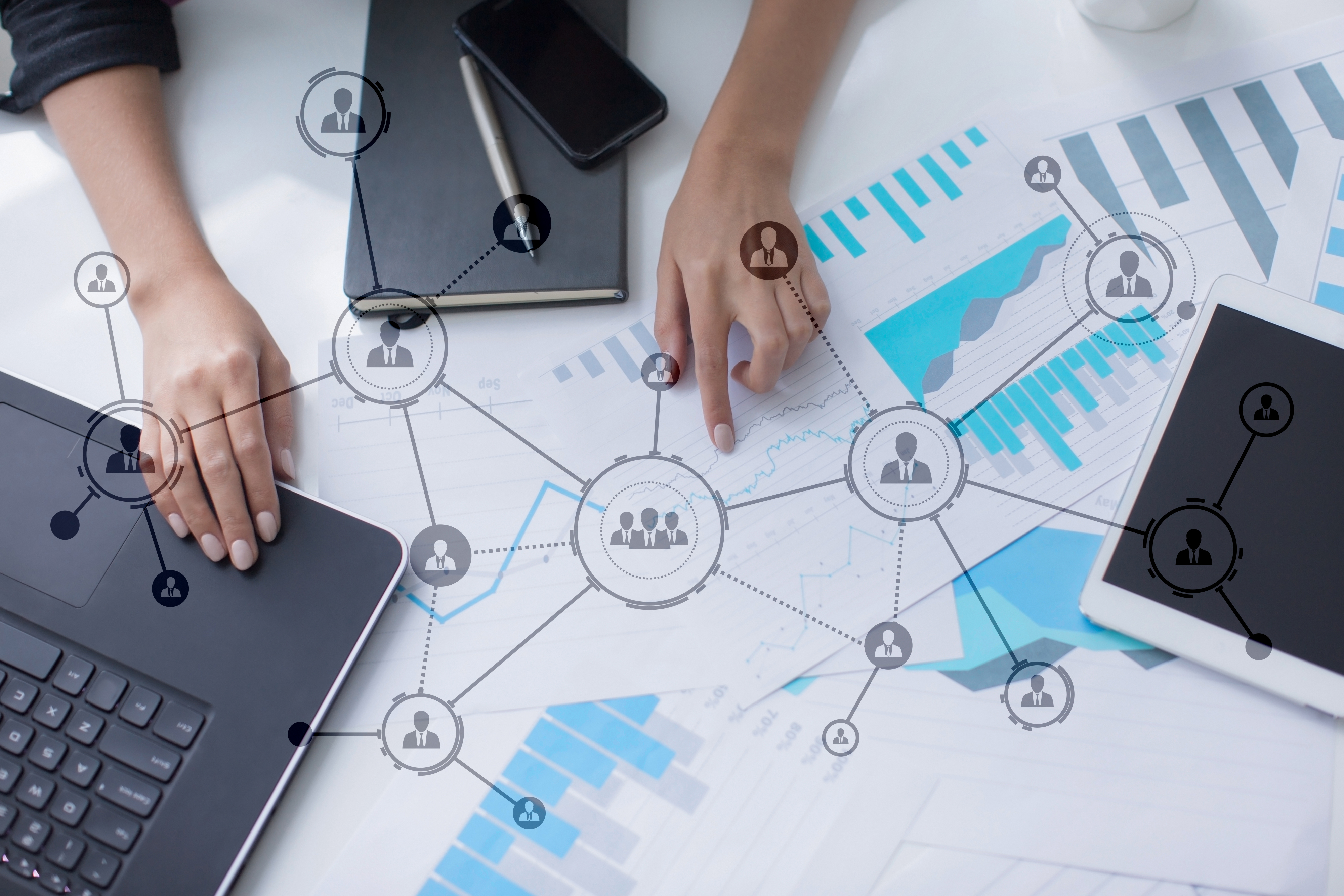 Workers with business diagrams and charts